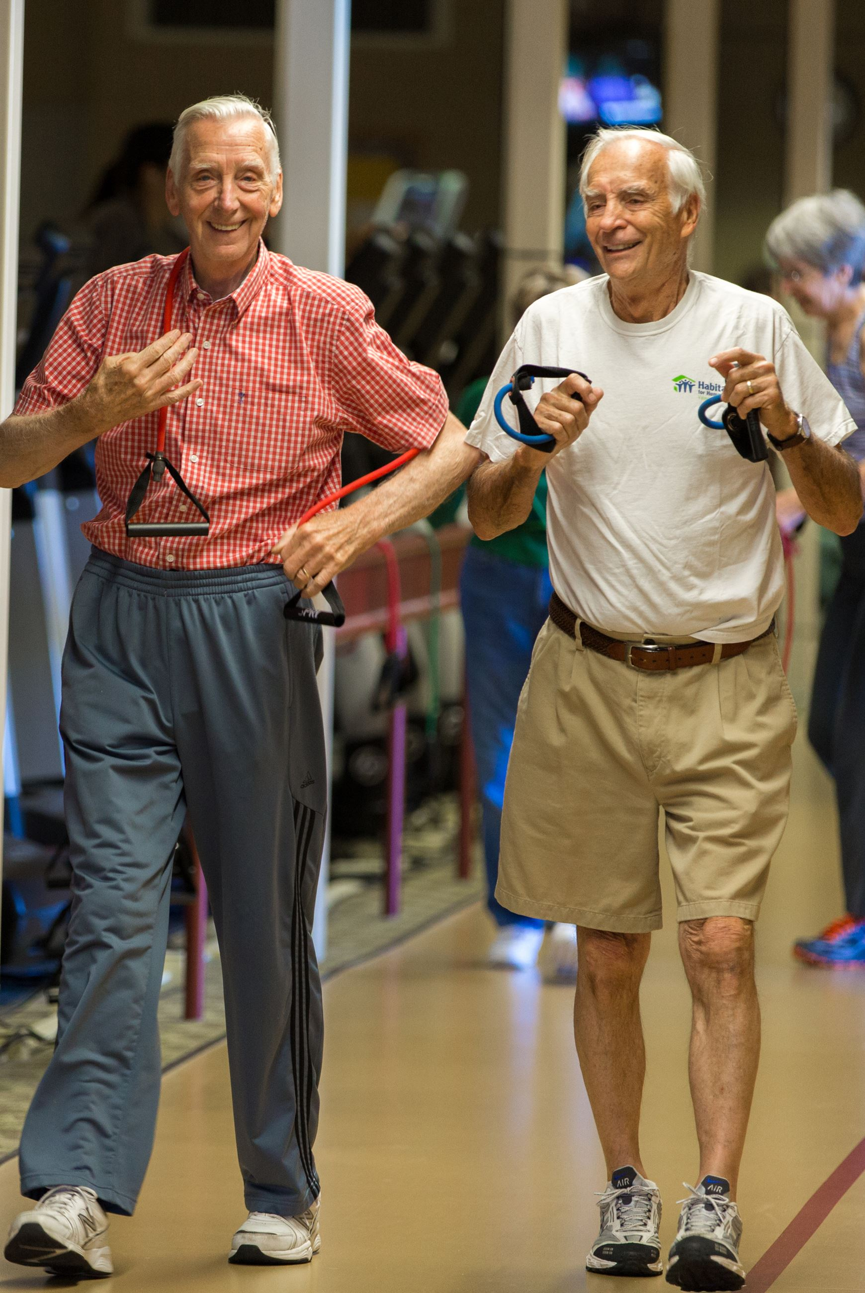 Walk and Weights - two men walking on an indoor track