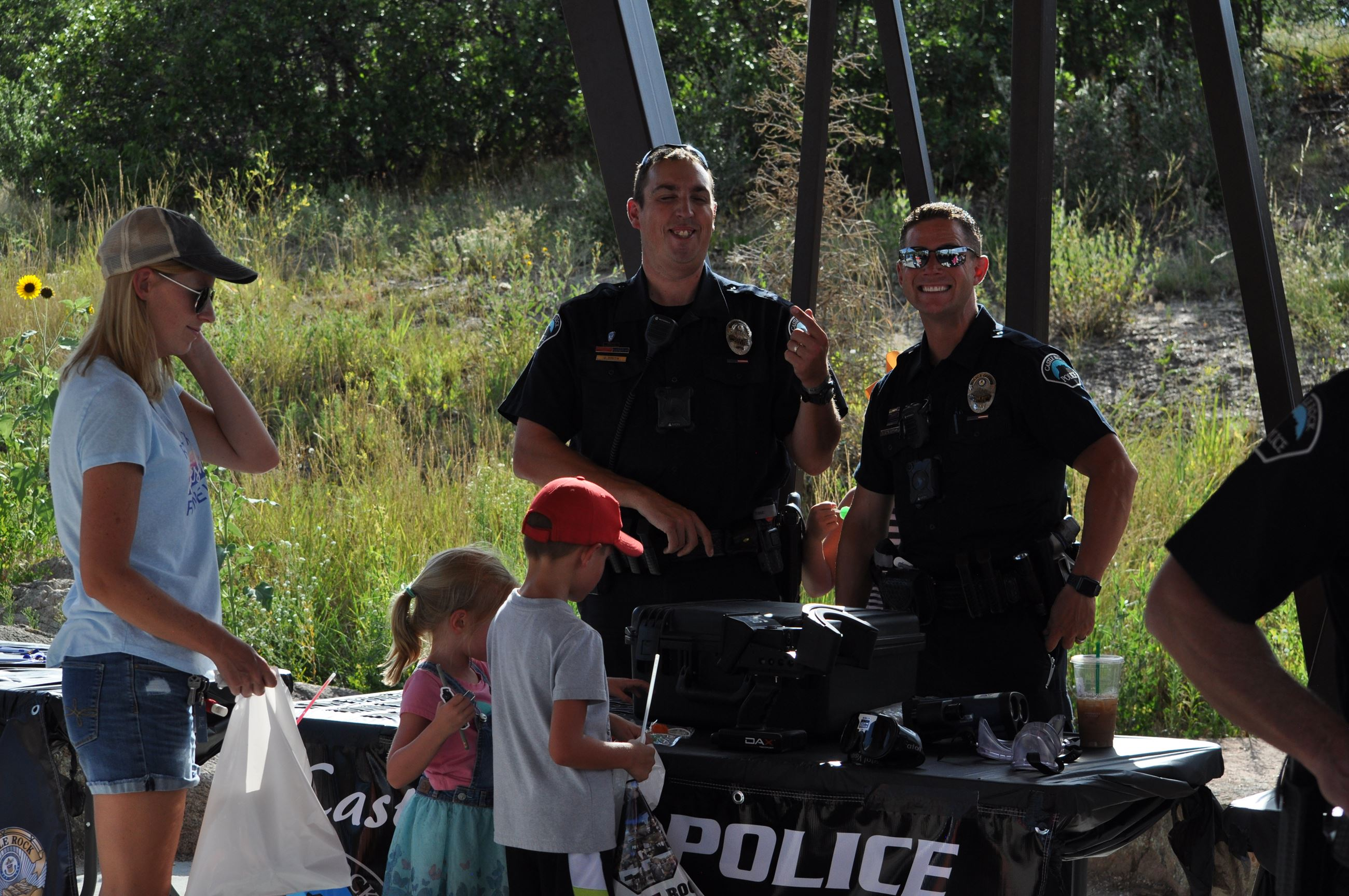 National Night Out photo of officers with children at a table