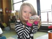 Girl holding decorated pet rock