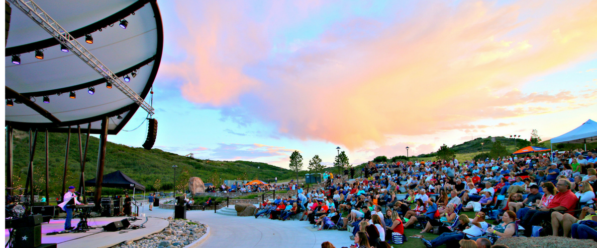 Concert goers enjoy live music and concert at the Amphitheater at Philip S. Miller Park