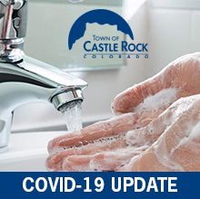 Washing hands with soap under faucet; Town of Castle Rock COVID-19 update