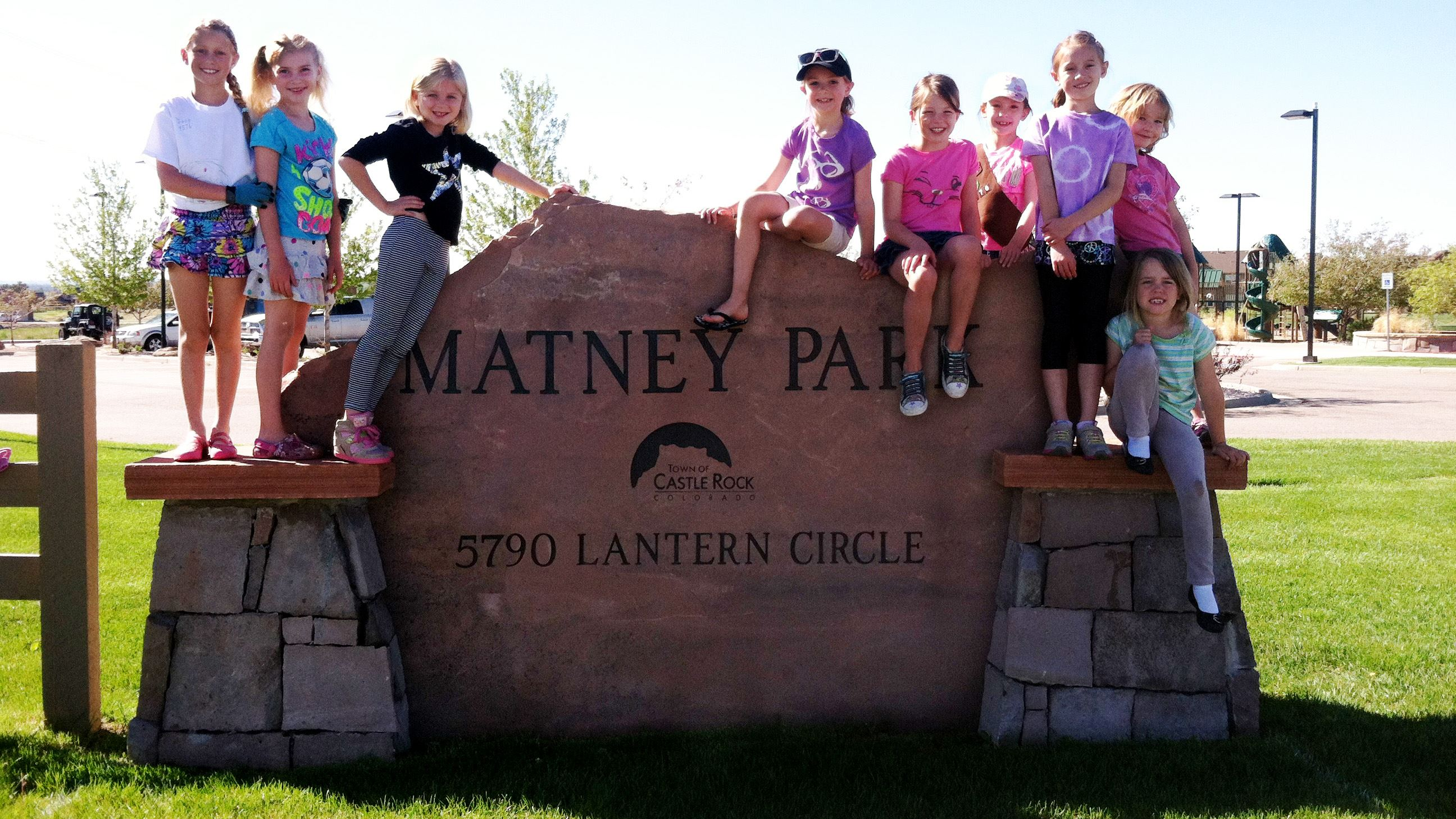 Matney Entrance sign with Girl Scouts